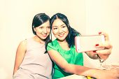 pic of two women taking cell phone  - Two girlfriends taking a selfie with smart phone  - JPG