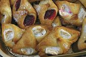 Assorted Cheese And Raspberry Pastry Bites