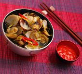 foto of clam  - herbal clam soup Vietnam style served on a place mat - JPG