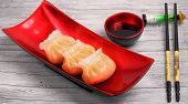 picture of siomai  - Vietnam style steamed shrimp dumplings served on a wood table top - JPG