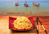 foto of carbonara  - spaghetti carbonara served on a wooden table top