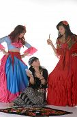 image of gypsy  - Three gypsy women posing in traditional outfits