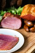 stock photo of smoked ham  - collage of different kinds of meat smoked ham with schwarzwald or prosciutto - JPG
