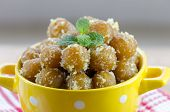 picture of jamun  - gulab jamuna popular sweet in Indiain a yellow bowl - JPG
