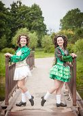 foto of cross-dress  - Two young beautiful girl in irish dance dress and wig posing outdoor - JPG