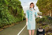 pic of air hostess  - Air hostess against scenic backdrop - JPG