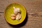 stock photo of ceramic bowl  - clove of garlic in a ceramic small bowl - JPG