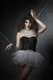image of gothic girl  - bizarre fashion portrait of brunette girl with gothic puppet costume - JPG