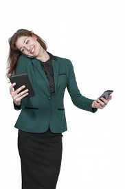 picture of juggling  - Beautiful woman talking texting and multitasking while juggling multiple cell phones and conversations - JPG