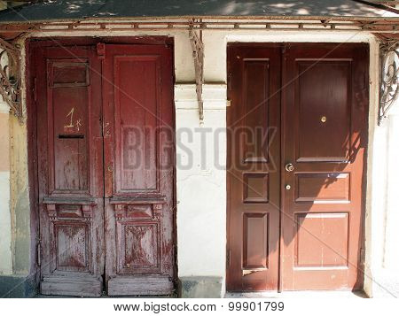 Old Brown Wooden Door And A New Brown Iron Door