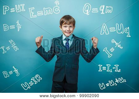 Teen boy genius gesture joy physics formulas around the photo st