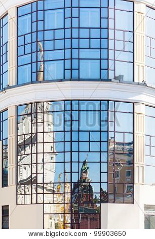 Historic Moscow Kremlin Tower Reflected In Windows