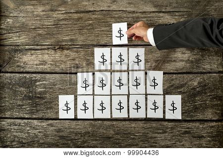 Overhead View Of Banker Or Financial Adviser Arranging White Cards With Dollar Sign In A Pyramid Sha