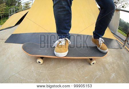 close up of skateboarding legs at skate park