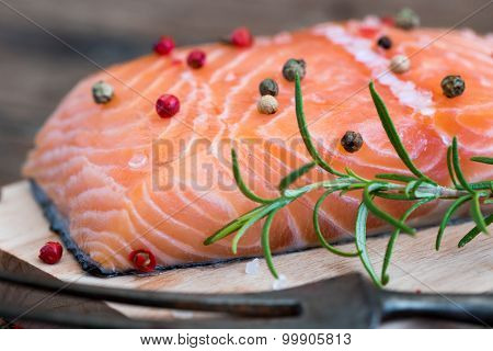 Raw Salmon Fish Fillet With Fresh Herbs