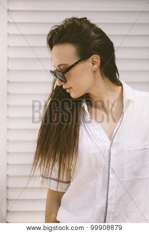 portrait of young woman with retro round sunglasses .
