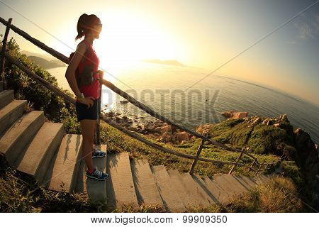 fitness woman trail  runner enjoy the view on sunrise seaside