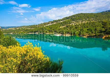 Spring Provence. Azure water reflects the clouds. The biggest mountain canyon in the French Alps - Verdon