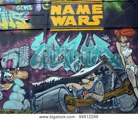 Street art Fred and Wilma Flintstone