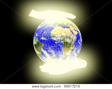 Planet Earth on palms  background.