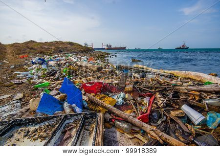 Colon, Panama - April 15, 2015: Enviromental Pollution Washing Ashore Next To The Panama Canal In Th