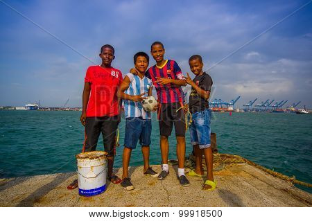Local Kids Hanging By The Harbor Where They Fish And Play Football In The Port Of Colon In Panama.