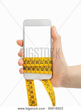 Holding The Smartphone And Measuring Tape