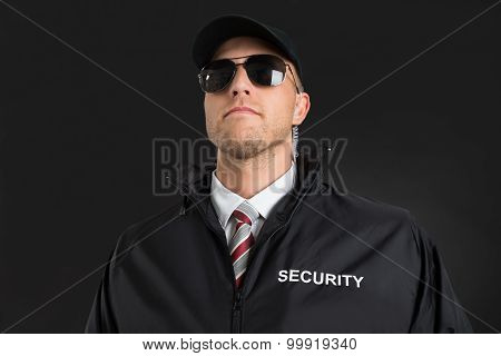 Bodyguard Wearing Sunglasses And Earpiece
