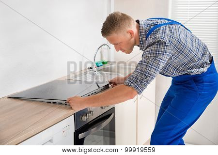 Repairman Installing Induction Cooker