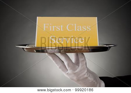 Plate With The Text First Class Service On Board