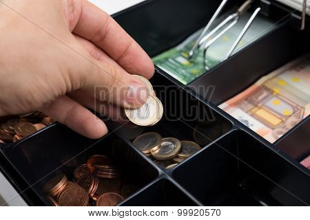 Person Hands Putting Coins In Cash Register