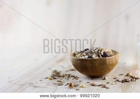 Muesli and granola in blurred wooden background. (Shallow aperture intended for the aesthetic qualit