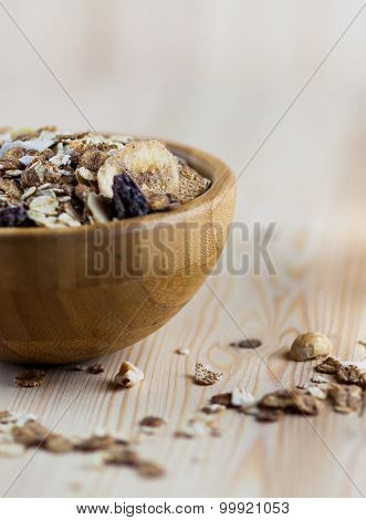 Close-up of Muesli and granola in blurred wooden background. (Shallow aperture intended for the aest