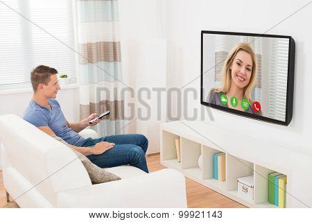 Man Video Chatting Using Television
