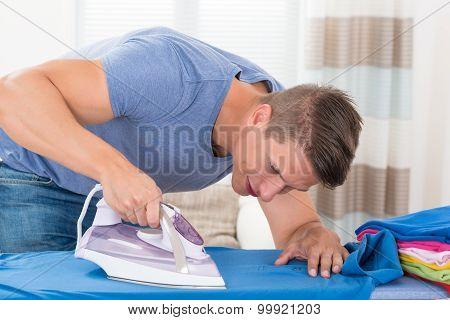 Man Ironing Clothes