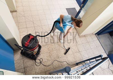 Janitor Vacuuming Floor