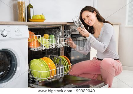 Woman Taking Drinking Glass From Dishwasher