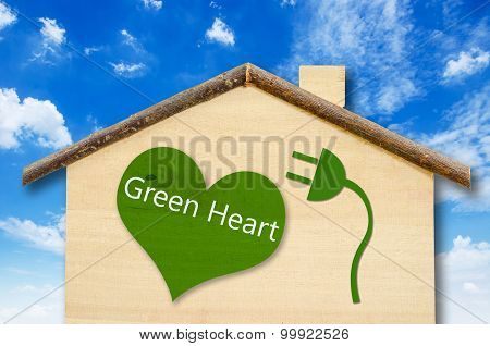 Eco House On Little Home Wooden Model On Blue Sky Background