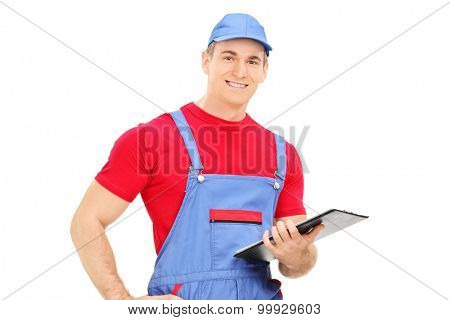 Mechanic holding a clipboard isolated on white background