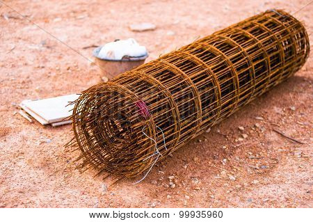 Rusty Fencing Material Laying On Floor