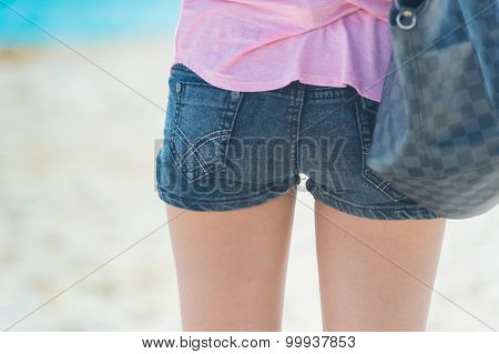 Young Fashion Woman In Jeans Shorts Posing On Beach