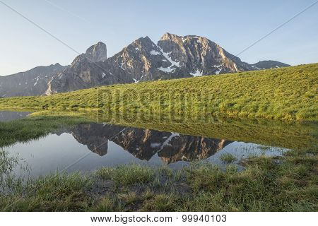 Alpine Lake And Reflection Of The Mountain In It. Dolomites High Alpine Peaks Reflection In The Lake
