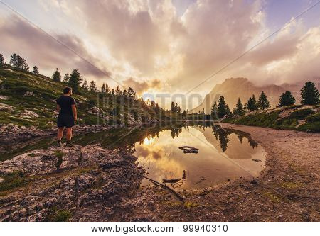 Male Hiker Gazing At Fascinating Reflections Of The Dolomites