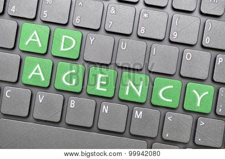 Green ad agency key on keyboard