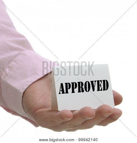 Business man holding approved sign on hand