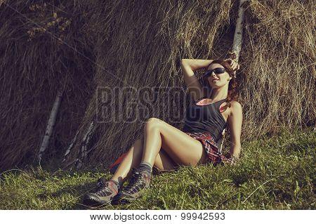 Woman Resting Near A Haystack