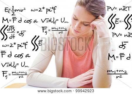 Student studying against maths equation