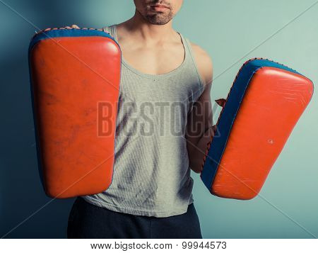 Athletic Young Man With Martial Arts Pads