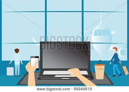 Hands Typing On A Laptop And Holding Smartphone Over Looking Airport Lounge.