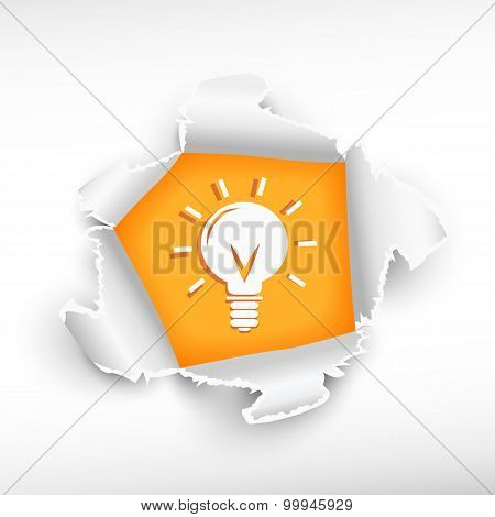 Light Bulb And Breakthrough Paper Hole